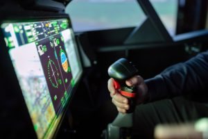 person controlling flight simulator